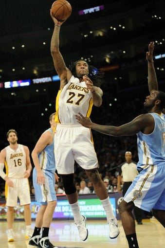 Jan 5, 2014; Los Angeles, CA, USA; Los Angeles Lakers center Jordan Hill (27) goes up for a shot against the Denver Nuggets during the third period at Staples Center. The Denver Nuggets defeated the Los Angeles Lakers 137-115. Mandatory Credit: Kelvin Kuo-USA TODAY Sports
