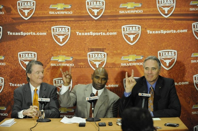Jan 6, 2014; Austin, TX, USA; Texas Longhorns president Bill Powers (left) and head football coach Charlie Strong (center) and athletics director Steve Patterson (right) speak at a press conference in the Centennial Room of Belmont Hall at Texas-Memorial Stadium. Mandatory Credit: Brendan Maloney-USA TODAY Sports