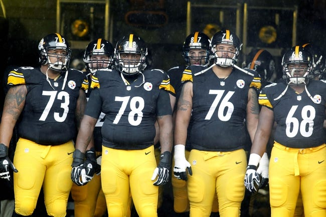Dec 29, 2013; Pittsburgh, PA, USA; Pittsburgh Steelers guard Ramon Foster (73) and guard Guy Whimper (78) and tackle Mike Adams (76) and tackle Kelvin Beachum (68) in the tunnel for player introductions before playing the Cleveland Browns at Heinz Field. The Steelers won 20-7. Mandatory Credit: Charles LeClaire-USA TODAY Sports