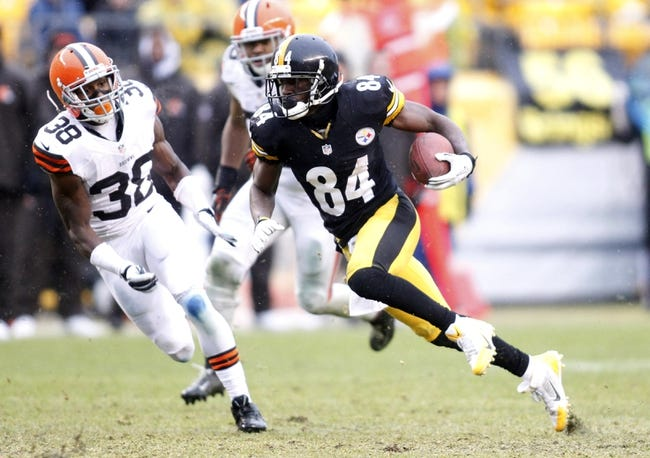 Dec 29, 2013; Pittsburgh, PA, USA; Pittsburgh Steelers wide receiver Antonio Brown (84) runs after a pass reception against Cleveland Browns defensive back Julian Posey (38) during the third quarter at Heinz Field. The Pittsburgh Steelers won 20-7. Mandatory Credit: Charles LeClaire-USA TODAY Sports