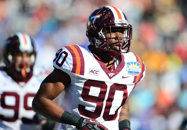 Dec 31, 2013; El Paso, TX, USA; Virginia Tech Hokies defensive end Dadi Nicolas (90) during the game against the UCLA Bruins in the 2013 Sun Bowl at Sun Bowl Stadium. UCLA defeated Virginia Tech 42-12. Mandatory Credit: Andrew Weber-USA TODAY Sports