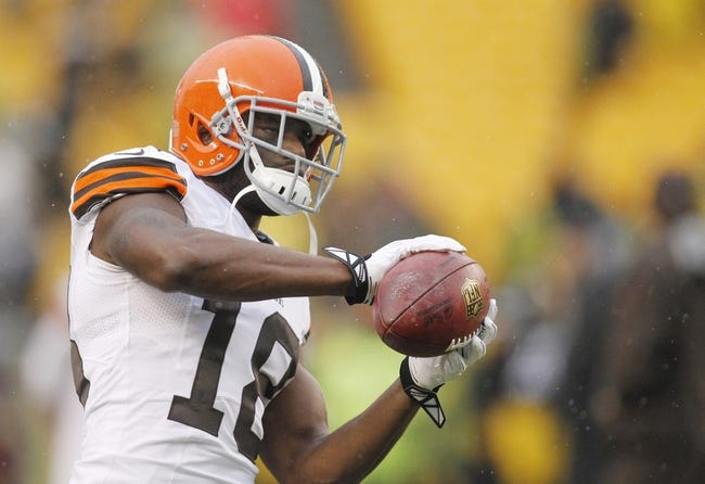 Dec 29, 2013; Pittsburgh, PA, USA; Cleveland Browns wide receiver Greg Little (18) warms up on the field before playing the Pittsburgh Steelers at Heinz Field. The Steelers won 20-7. Mandatory Credit: Charles LeClaire-USA TODAY Sports