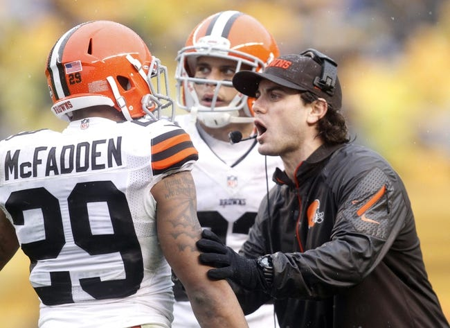 Dec 29, 2013; Pittsburgh, PA, USA; Cleveland Browns cornerback Leon McFadden (29) receives instructions from Browns defensive backs coach Bobby Babich (right) against the Pittsburgh Steelers during the second quarter at Heinz Field. The Steelers won 20-7. Mandatory Credit: Charles LeClaire-USA TODAY Sports
