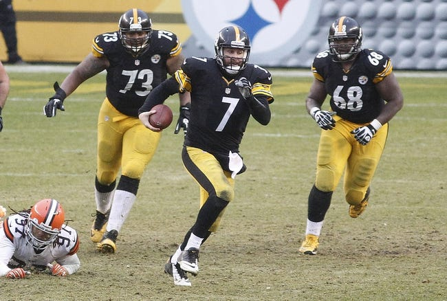 Dec 29, 2013; Pittsburgh, PA, USA; Pittsburgh Steelers quarterback Ben Roethlisberger (7) scrambles with the ball against the Cleveland Browns during the fourth quarter at Heinz Field. The Steelers won 20-7. Mandatory Credit: Charles LeClaire-USA TODAY Sports