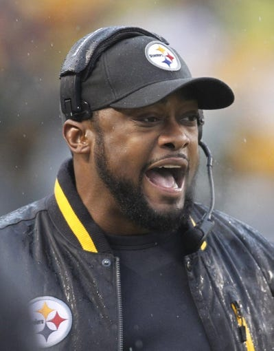 Dec 29, 2013; Pittsburgh, PA, USA; Pittsburgh Steelers head coach Mike Tomlin reacts to a play before the game against the Cleveland Browns at Heinz Field. The Steelers won 20-7. Mandatory Credit: Charles LeClaire-USA TODAY Sports