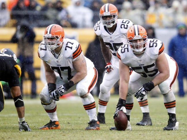 Dec 29, 2013; Pittsburgh, PA, USA; Cleveland Browns guard John Greco (77) and running back Chris Ogbonnaya (25) and center Alex Mack (55) at the line of scrimmage against the Pittsburgh Steelers during the second quarter at Heinz Field. The Steelers won 20-7. Mandatory Credit: Charles LeClaire-USA TODAY Sports