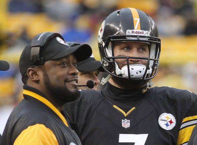 Dec 29, 2013; Pittsburgh, PA, USA; Pittsburgh Steelers head coach Mike Tomlin (left) and quarterback Ben Roethlisberger (7) react during a time-out against the Cleveland Browns during the fourth quarter at Heinz Field. The Pittsburgh Steelers won 20-7.  Mandatory Credit: Charles LeClaire-USA TODAY Sports
