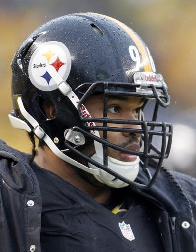 Dec 29, 2013; Pittsburgh, PA, USA; Pittsburgh Steelers defensive end Ziggy Hood (96) looks on from the sidelines before the game against the Cleveland Browns at Heinz Field. The Steelers won 20-7. Mandatory Credit: Charles LeClaire-USA TODAY Sports
