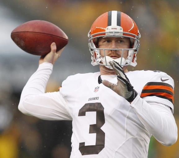 Dec 29, 2013; Pittsburgh, PA, USA; Cleveland Browns quarterback Brandon Weeden (3) warms up on the field before playing the Pittsburgh Steelers at Heinz Field. The Steelers won 20-7. Mandatory Credit: Charles LeClaire-USA TODAY Sports