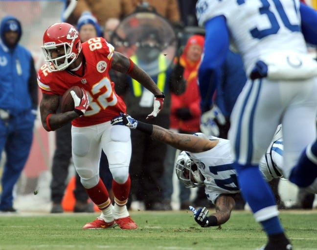 Dec 22, 2013; Kansas City, MO, USA; Kansas City Chiefs wide receiver Dwayne Bowe (82) runs the ball as Indianapolis Colts strong safety Antoine Bethea (41) attempts the tackle in the first half at Arrowhead Stadium. The Colts won 23-7. Mandatory Credit: Denny Medley-USA TODAY Sports