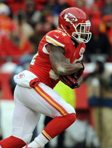 Dec 22, 2013; Kansas City, MO, USA; Kansas City Chiefs running back Knile Davis (34) runs the ball during the second half of the game against the Indianapolis Colts at Arrowhead Stadium. The Colts won 23-7. Mandatory Credit: Denny Medley-USA TODAY Sports