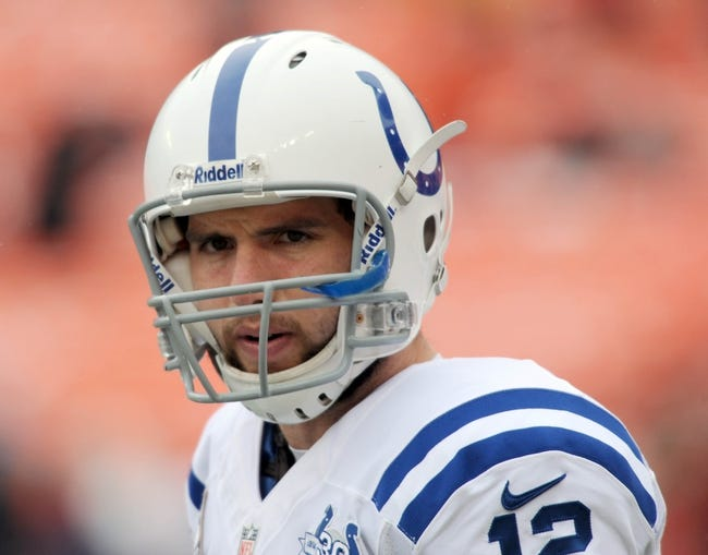 Dec 22, 2013; Kansas City, MO, USA; Indianapolis Colts quarterback Andrew Luck (12) warms up before the game against the Kansas City Chiefs at Arrowhead Stadium. The Colts won 23-7. Mandatory Credit: Denny Medley-USA TODAY Sports