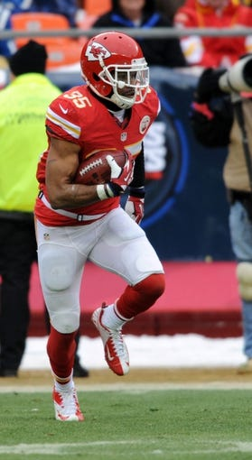Dec 22, 2013; Kansas City, MO, USA; Kansas City Chiefs defensive back Quintin Demps (35) returns a kick during the second half of the game against the Indianapolis Colts at Arrowhead Stadium. The Colts won 23-7. Mandatory Credit: Denny Medley-USA TODAY Sports