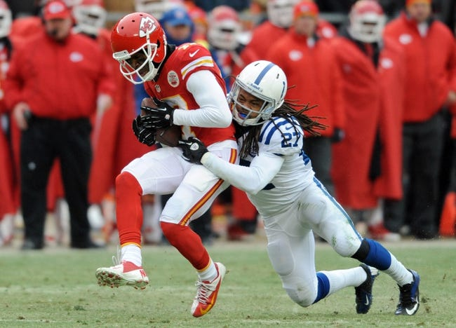 Dec 22, 2013; Kansas City, MO, USA; Kansas City Chiefs wide receiver Donnie Avery (17) is tackled by Indianapolis Colts defensive back Josh Gordy (27) during the second half at Arrowhead Stadium. The Colts won 23-7. Mandatory Credit: Denny Medley-USA TODAY Sports