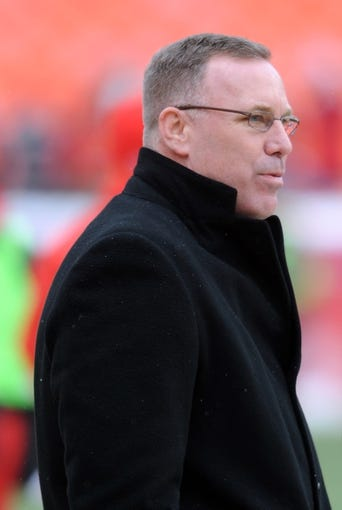 Dec 22, 2013; Kansas City, MO, USA; Kansas City Chiefs general manager John Dorsey watches the team warm up before the game against the Indianapolis Colts at Arrowhead Stadium. The Colts won 23-7. Mandatory Credit: Denny Medley-USA TODAY Sports