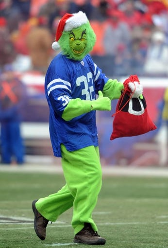Dec 22, 2013; Kansas City, MO, USA; A man dressed as the Grinch performs for the crowd before the game between the Kansas City Chiefs and Indianapolis Colts at Arrowhead Stadium. The Colts won 23-7. Mandatory Credit: Denny Medley-USA TODAY Sports