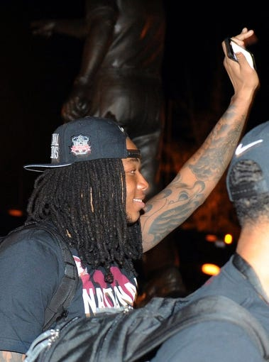 Jan 7, 2014; Tallahassee, FL, USA; Florida State Seminoles wide receiver Kelvin Benjamin greets fans as they welcome back players to Doak Campbell Stadium after winning the BCS National Championship. Mandatory Credit: Melina Vastola-USA TODAY Sports