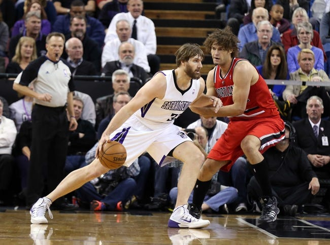 Jan 7, 2014; Sacramento, CA, USA; Sacramento Kings center Aaron Gray (33) drives in against Portland Trail Blazers center Robin Lopez (42) during the second quarter at Sleep Train Arena. Mandatory Credit: Kelley L Cox-USA TODAY Sports