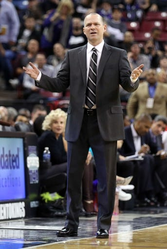 Jan 7, 2014; Sacramento, CA, USA; Sacramento Kings head coach Michael Malone questions the foul during the second quarter against the Portland Trail Blazers at Sleep Train Arena. Mandatory Credit: Kelley L Cox-USA TODAY Sports