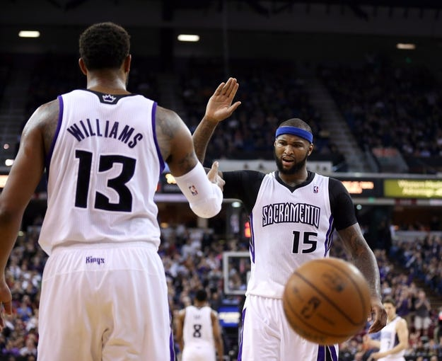 Jan 7, 2014; Sacramento, CA, USA; Sacramento Kings center DeMarcus Cousins (15) high fives power forward Derrick Williams (13) after a play against the Portland Trail Blazers during the fourth quarter at Sleep Train Arena. The Sacramento Kings defeated the Portland Trail Blazers 123-119. Mandatory Credit: Kelley L Cox-USA TODAY Sports
