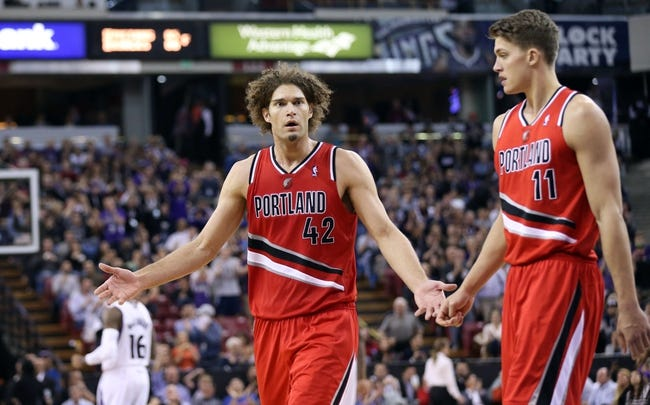 Jan 7, 2014; Sacramento, CA, USA; Portland Trail Blazers center Robin Lopez (42) reacts after being called for a foul against the Sacramento Kings during the fourth quarter at Sleep Train Arena. The Sacramento Kings defeated the Portland Trail Blazers 123-119. Mandatory Credit: Kelley L Cox-USA TODAY Sports