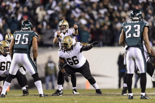 Jan 4, 2014; Philadelphia, PA, USA; New Orleans Saints guard Ben Grubbs (66) points out coverage during the first quarter against the Philadelphia Eagles during the 2013 NFC wild card playoff football game at Lincoln Financial Field. The Saints defeated the Eagles 26-24. Mandatory Credit: Howard Smith-USA TODAY Sports