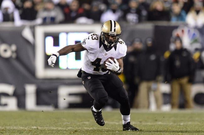 Jan 4, 2014; Philadelphia, PA, USA; New Orleans Saints running back Darren Sproles (43) carries the ball during the first quarter against the Philadelphia Eagles during the 2013 NFC wild card playoff football game at Lincoln Financial Field. The Saints defeated the Eagles 26-24. Mandatory Credit: Howard Smith-USA TODAY Sports