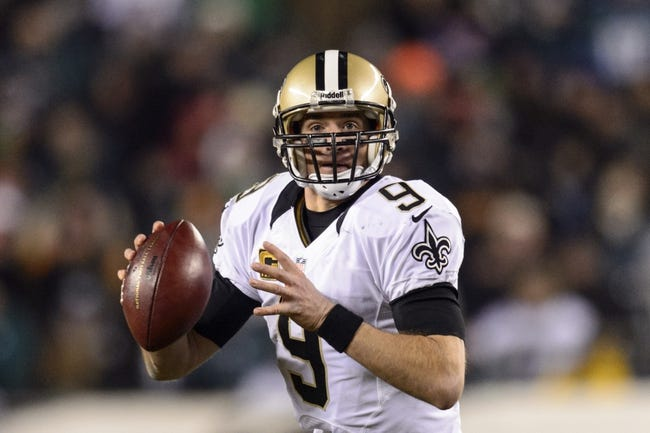 Jan 4, 2014; Philadelphia, PA, USA; New Orleans Saints quarterback Drew Brees (9) rolls out during the third quarter against the Philadelphia Eagles during the 2013 NFC wild card playoff football game at Lincoln Financial Field. The Saints defeated the Eagles 26-24. Mandatory Credit: Howard Smith-USA TODAY Sports