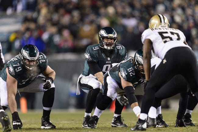 Jan 4, 2014; Philadelphia, PA, USA; Philadelphia Eagles quarterback Nick Foles (9) under center during the first quarter against the New Orleans Saints during the 2013 NFC wild card playoff football game at Lincoln Financial Field. The Saints defeated the Eagles 26-24. Mandatory Credit: Howard Smith-USA TODAY Sports