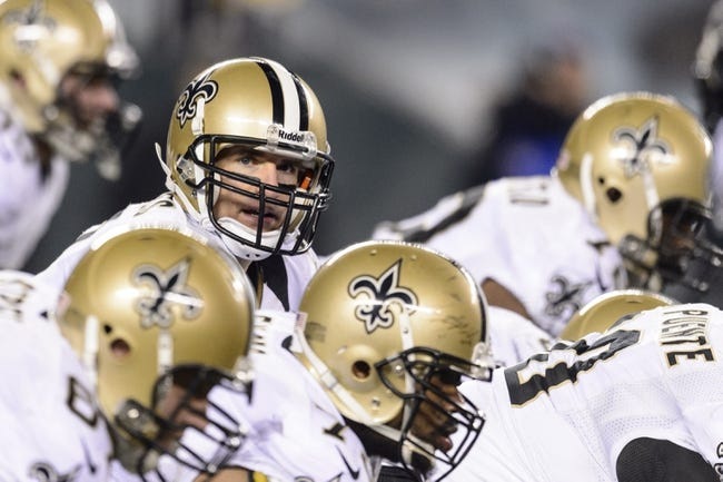Jan 4, 2014; Philadelphia, PA, USA; New Orleans Saints quarterback Drew Brees (9) under center during the third quarter against the Philadelphia Eagles during the 2013 NFC wild card playoff football game at Lincoln Financial Field. The Saints defeated the Eagles 26-24. Mandatory Credit: Howard Smith-USA TODAY Sports