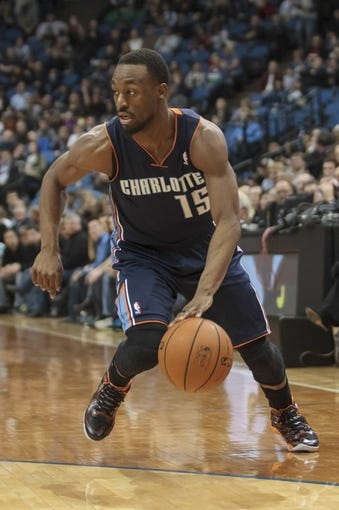 Jan 10, 2014; Minneapolis, MN, USA; Charlotte Bobcats guard Kemba Walker (15) dribbles in the first quarter against the Minnesota Timberwolves at Target Center. Mandatory Credit: Brad Rempel-USA TODAY Sports