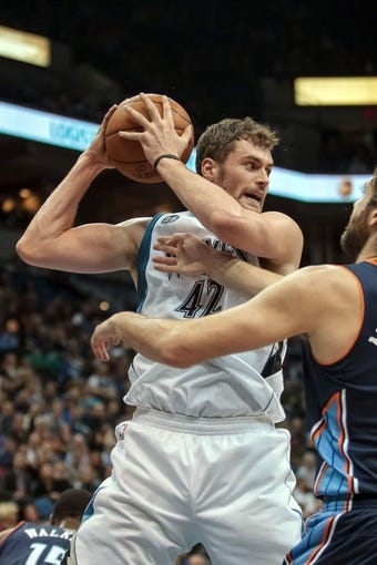 Jan 10, 2014; Minneapolis, MN, USA; Minnesota Timberwolves power forward Kevin Love (42) rebounds in the first quarter against the Charlotte Bobcats at Target Center. Mandatory Credit: Brad Rempel-USA TODAY Sports
