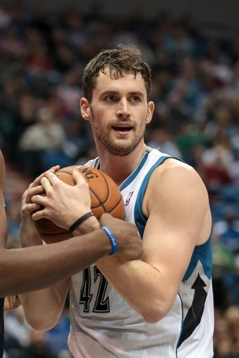 Jan 10, 2014; Minneapolis, MN, USA; Minnesota Timberwolves power forward Kevin Love (42) holds onto the ball in the third quarter against the Charlotte Bobcats at Target Center. Minnesota wins 119-92. Mandatory Credit: Brad Rempel-USA TODAY Sports
