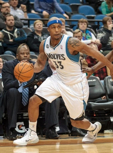 Jan 10, 2014; Minneapolis, MN, USA; Minnesota Timberwolves power forward Dante Cunningham (33) dribbles in the fourth quarter against the Charlotte Bobcats at Target Center. Minnesota wins 119-92. Mandatory Credit: Brad Rempel-USA TODAY Sports
