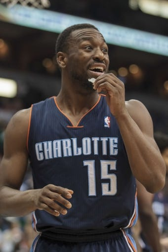 Jan 10, 2014; Minneapolis, MN, USA; Charlotte Bobcats guard Kemba Walker (15) reacts to a foul in the third quarter against the Minnesota Timberwolves at Target Center. Minnesota wins 119-92. Mandatory Credit: Brad Rempel-USA TODAY Sports