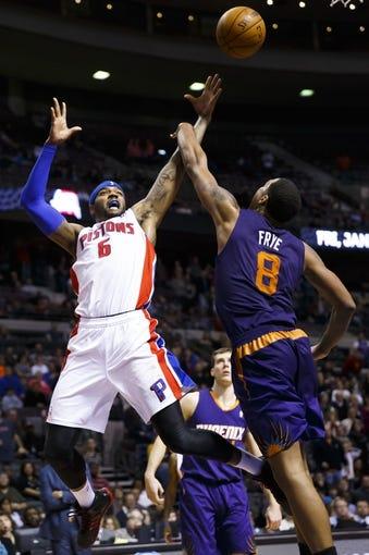 Jan 11, 2014; Auburn Hills, MI, USA; Detroit Pistons small forward Josh Smith (6) shoots over Phoenix Suns power forward Channing Frye (8) in the fourth quarter at The Palace of Auburn Hills. Detroit won 110-108. Mandatory Credit: Rick Osentoski-USA TODAY Sports