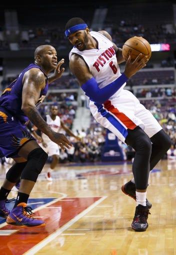 Jan 11, 2014; Auburn Hills, MI, USA; Detroit Pistons small forward Josh Smith (6) is defended by Phoenix Suns small forward P.J. Tucker (17) in the fourth quarter at The Palace of Auburn Hills. Detroit won 110-108. Mandatory Credit: Rick Osentoski-USA TODAY Sports