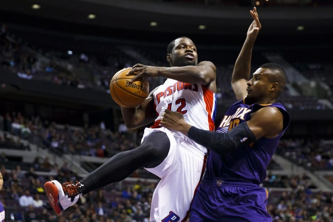 Jan 11, 2014; Auburn Hills, MI, USA; Detroit Pistons point guard Will Bynum (12) passes the ball defended by Phoenix Suns guard Leandro Barbosa (10) in the fourth quarter at The Palace of Auburn Hills. Detroit won 110-108. Mandatory Credit: Rick Osentoski-USA TODAY Sports