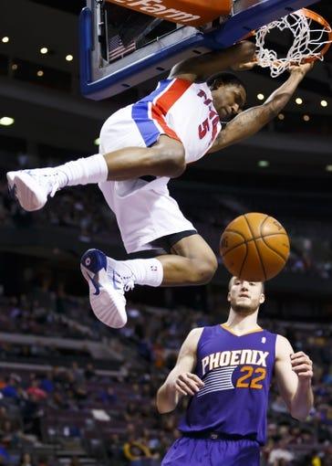 Jan 11, 2014; Auburn Hills, MI, USA; Detroit Pistons shooting guard Kentavious Caldwell-Pope (5) dunks on Phoenix Suns center Miles Plumlee (22) in the third quarter at The Palace of Auburn Hills. Detroit won 110-108. Mandatory Credit: Rick Osentoski-USA TODAY Sports