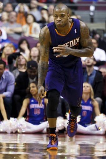 Jan 11, 2014; Auburn Hills, MI, USA; Phoenix Suns small forward P.J. Tucker (17) reacts after making a three point shot in the fourth quarter against the Detroit Pistons at The Palace of Auburn Hills. Detroit won 110-108. Mandatory Credit: Rick Osentoski-USA TODAY Sports