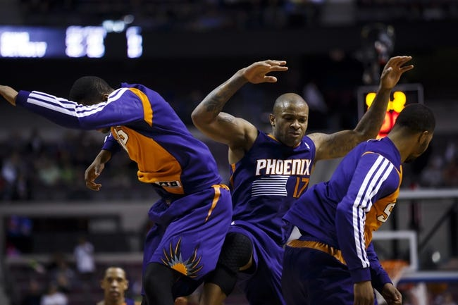 Jan 11, 2014; Auburn Hills, MI, USA; Phoenix Suns small forward P.J. Tucker (17) receives congratulations from teammates after making a three point shot to tie the game in the fourth quarter against the Detroit Pistons at The Palace of Auburn Hills. Detroit won 110-108. Mandatory Credit: Rick Osentoski-USA TODAY Sports