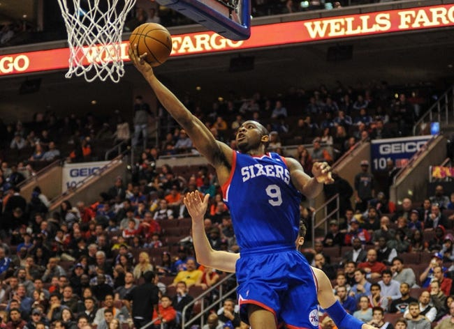 Jan 11, 2014; Philadelphia, PA, USA; Philadelphia 76ers shooting guard James Anderson (9) makes a lay up during the game against the New York Knicks at the Wells Fargo Center. The New York Knicks won 102-92.Mandatory Credit: John Geliebter-USA TODAY Sports
