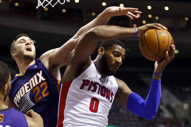 Jan 11, 2014; Auburn Hills, MI, USA; Detroit Pistons center Andre Drummond (0) grabs the rebound over Phoenix Suns center Miles Plumlee (22) in the first half at The Palace of Auburn Hills. Mandatory Credit: Rick Osentoski-USA TODAY Sports