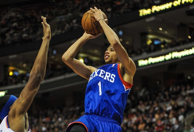 Jan 11, 2014; Philadelphia, PA, USA; Philadelphia 76ers point guard Michael Carter-Williams (1) takes a shot during the game against the New York Knicks at the Wells Fargo Center. The New York Knicks won 102-92.Mandatory Credit: John Geliebter-USA TODAY Sports