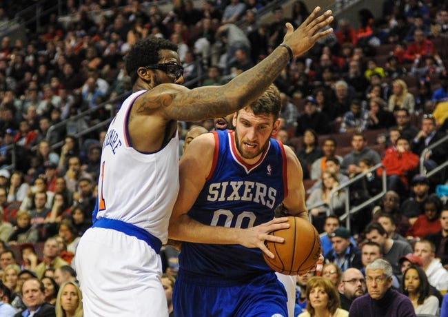 Jan 11, 2014; Philadelphia, PA, USA; Philadelphia 76ers center Spencer Hawes (00) drives to the net as New York Knicks power forward Amar'e Stoudemire (1) defends during the game at the Wells Fargo Center. The New York Knicks won 102-92.Mandatory Credit: John Geliebter-USA TODAY Sports