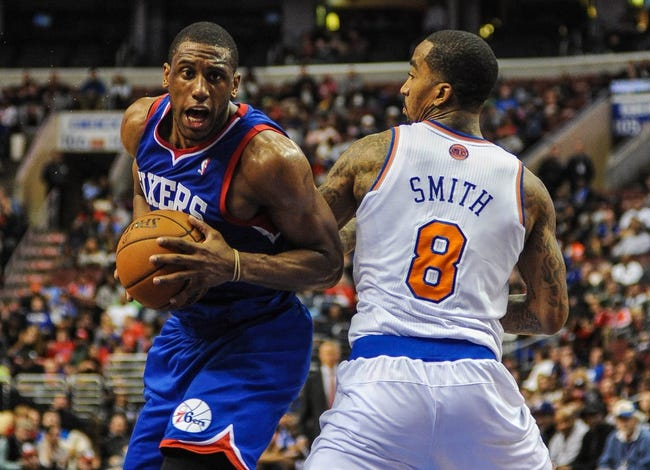 Jan 11, 2014; Philadelphia, PA, USA; Philadelphia 76ers power forward Thaddeus Young (21) drives to the net as New York Knicks shooting guard J.R. Smith (8) defends during the game at the Wells Fargo Center. The New York Knicks won 102-92.Mandatory Credit: John Geliebter-USA TODAY Sports