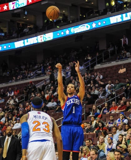 Jan 11, 2014; Philadelphia, PA, USA; Philadelphia 76ers point guard Michael Carter-Williams (1) takes a jump shot during the game against the New York Knicks at the Wells Fargo Center. The New York Knicks won 102-92.Mandatory Credit: John Geliebter-USA TODAY Sports