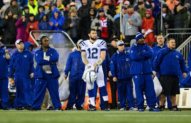 Jan 11, 2014; Foxborough, MA, USA; Indianapolis Colts quarterback Andrew Luck (12) on the sidelines during the fourth quarter of the 2013 AFC divisional playoff football game against the New England Patriots at Gillette Stadium. Mandatory Credit: Andrew Weber-USA TODAY Sports