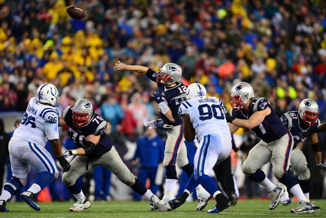 Jan 11, 2014; Foxborough, MA, USA; New England Patriots quarterback Tom Brady (12) throws a pass during the fourth quarter of the 2013 AFC divisional playoff football game against the Indianapolis Colts at Gillette Stadium. Mandatory Credit: Andrew Weber-USA TODAY Sports