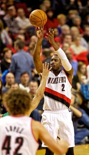 Jan 11, 2014; Portland, OR, USA; Portland Trail Blazers shooting guard Wesley Matthews (2) shoots against the Boston Celtics at the Moda Center. Mandatory Credit: Craig Mitchelldyer-USA TODAY Sports